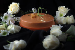 Chocolate dessert in flowers on black. Background royalty free stock images