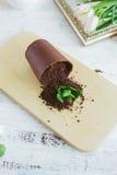 Chocolate dessert in the form of a fallen flower pot Stock Photos