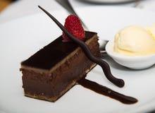 Chocolate Dessert Garnished with Raspberry and Ice Cream Royalty Free Stock Photo