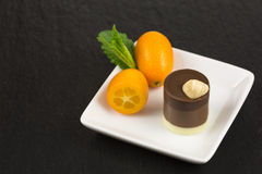 Chocolate dessert with kumquat Royalty Free Stock Images