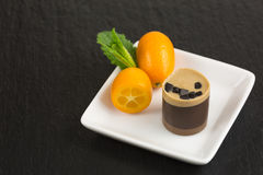 Chocolate dessert with kumquat Royalty Free Stock Photo