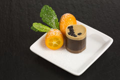 Chocolate dessert with kumquat Stock Photo