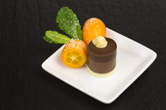 Chocolate dessert with kumquat Stock Photography