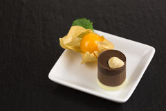 Chocolate dessert with physalis Royalty Free Stock Images