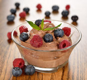 Chocolate dessert with raspberries and blueberries Royalty Free Stock Photos