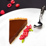 Chocolate dessert with raspberry. Dark chocolate cake with choco Royalty Free Stock Photos