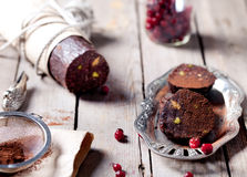 Chocolate dessert salami with cranberries Royalty Free Stock Photo