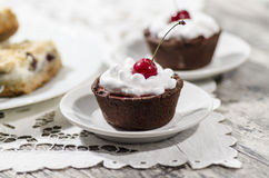 Chocolate dessert with whipped cream and a cherry stock photos