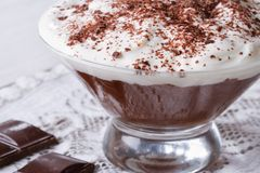 Chocolate dessert with whipped cream close-up. Horizontal Stock Photos