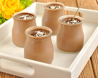 Chocolate desserts. In jars stock photo