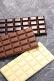 Chocolate in diffrent color. milk, dark and white chocolate bars.  royalty free stock photo