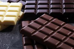Chocolate in diffrent color. milk, dark and white chocolate bars.  royalty free stock images