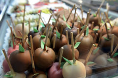 Chocolate-dipped apples on the market of Oktoberfest Stock Images