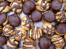 Chocolate dipped cream puffs. On waxpaper Royalty Free Stock Photography