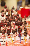 Chocolate dipped strawberries at dessert bar Royalty Free Stock Photography