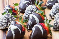 Chocolate dipped strawberries. Hand dipped strawberries in chocolates with some rolled in roasted cashews and some with a white chocolate drizzle Stock Photos