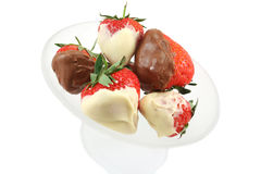 Chocolate Dipped Strawberries Overhead View. Milk and white chocolate dipped strawberries in a frosted glass bowl Stock Photography