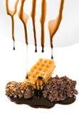 Chocolate do líquido do gotejamento foto de stock