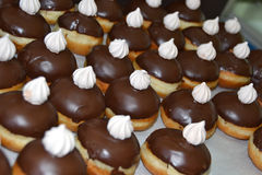 Chocolate donut. Chocolate doughnut with a sugar kiss Stock Images