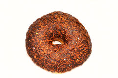 Chocolate donut with candy. Isolated on white Royalty Free Stock Image
