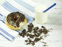 Chocolate Donut Beside Chunked Chocolates Stock Photo