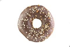 Chocolate donut with nut crumb on a white background. Isolated Donut royalty free stock photography