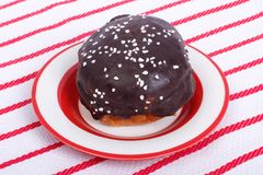 Chocolate donut on a plate against Royalty Free Stock Photography