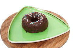 Chocolate donut served on the green plate Stock Image