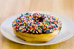 Chocolate Donut with sprinkles Stock Image
