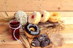 Chocolate donut and strawberry jam donut of delicious Stock Images