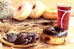 Chocolate donut and strawberry jam donut of delicious Royalty Free Stock Photos