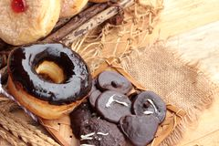 Chocolate donut and strawberry jam donut of delicious Royalty Free Stock Photo