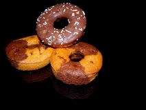 Chocolate donut with white crumbs stock images