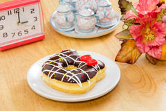 Chocolate Donut  on the wooden table Royalty Free Stock Images