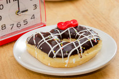 Chocolate Donut  on the wooden table Stock Photo
