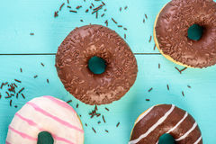 Chocolate Donuts On Blue Background Royalty Free Stock Images