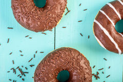 Chocolate Donuts On Blue Background Stock Photos