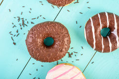 Chocolate Donuts On Blue Background Royalty Free Stock Photos