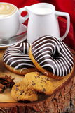 Chocolate donuts and cappuccino Stock Images