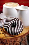 Chocolate donuts and cappuccino Royalty Free Stock Photo