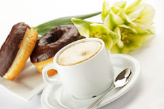 Chocolate donuts with coffee royalty free stock image