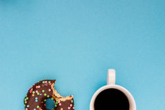 Chocolate donuts with coffee on the blue background. Delicious donut Royalty Free Stock Images