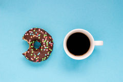 Chocolate donuts with coffee on the blue background. Delicious donut Stock Photo