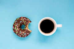 Chocolate donuts with coffee on the blue background. Delicious donut Stock Photos