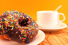Chocolate donuts and coffee cup Stock Image