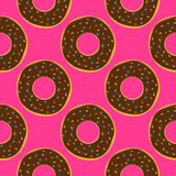 Chocolate donuts with colored glaze. Colorful seamless pattern. Royalty Free Stock Photos