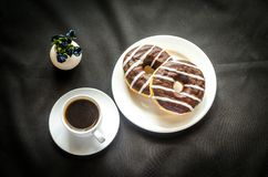 Chocolate donuts with a cup of coffee Stock Photography