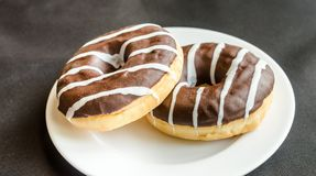 Chocolate donuts with a cup of coffee Stock Photo