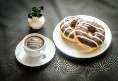 Chocolate donuts with a cup of coffee Royalty Free Stock Image
