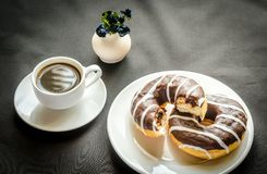Chocolate donuts with a cup of coffee Royalty Free Stock Photo